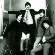 Music group The Kinks, posing on the fli